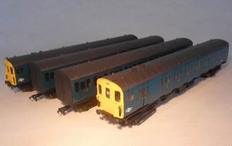 A yellow and black train  Description automatically generated